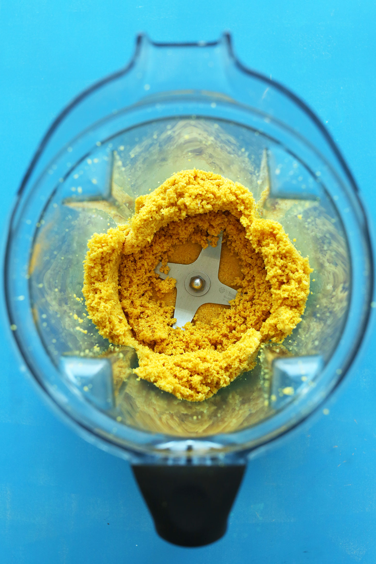Blender with ingredients for making homemade healthy macaroons with turmeric