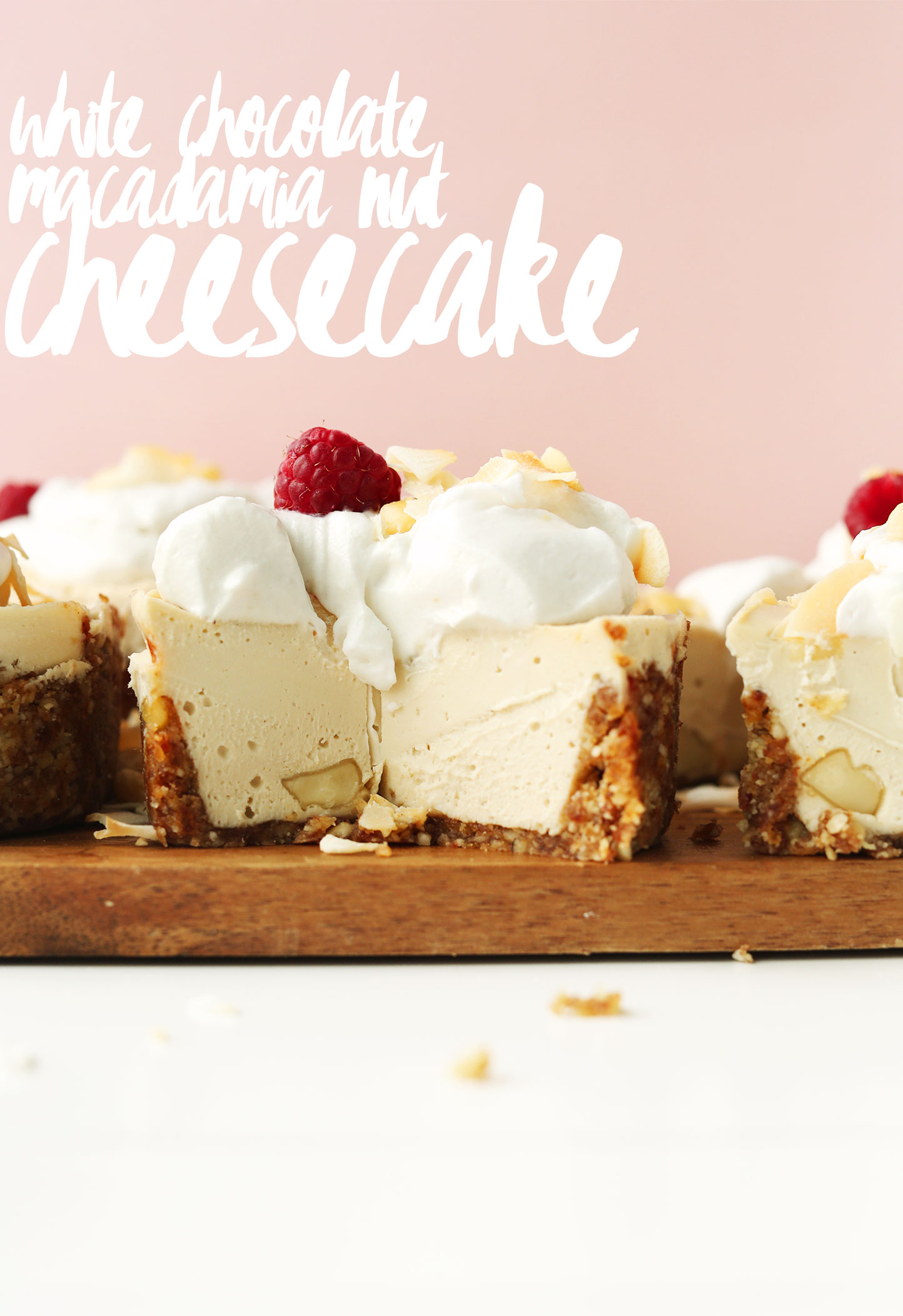 Mini White Chocolate Macadamia Nut Cheesecake topped with coconut whip and a raspberry