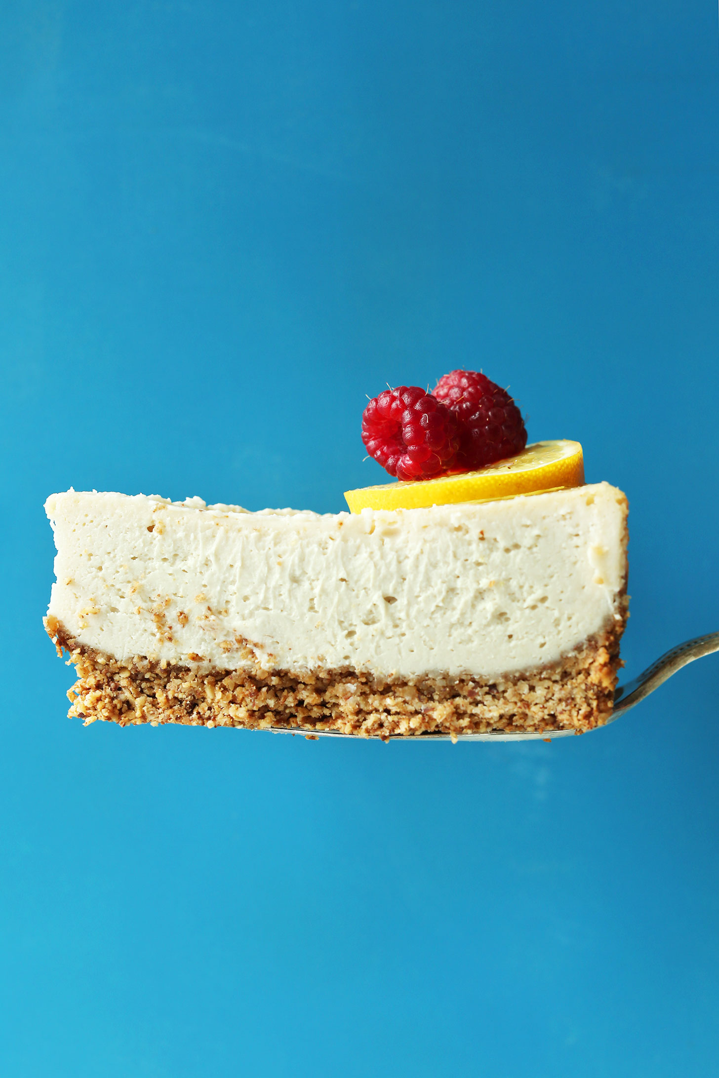 Slice of our easy vegan gluten-free baked cheesecake