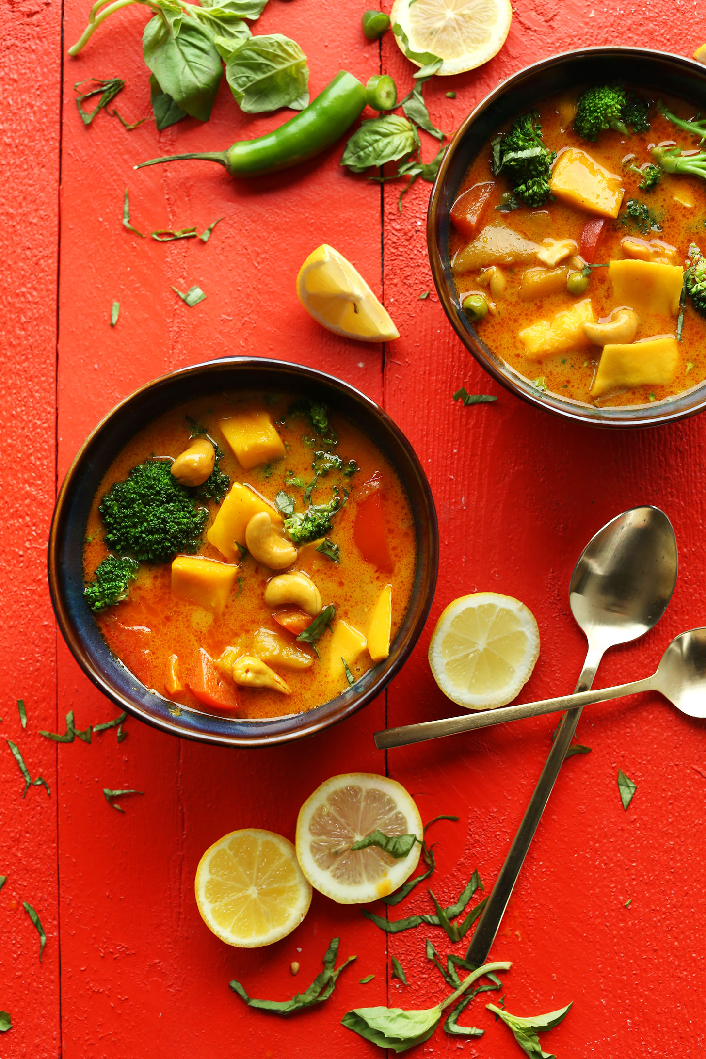 Two bowls of our Yellow Thai Mango Curry recipe for an easy gluten-free vegan dinner