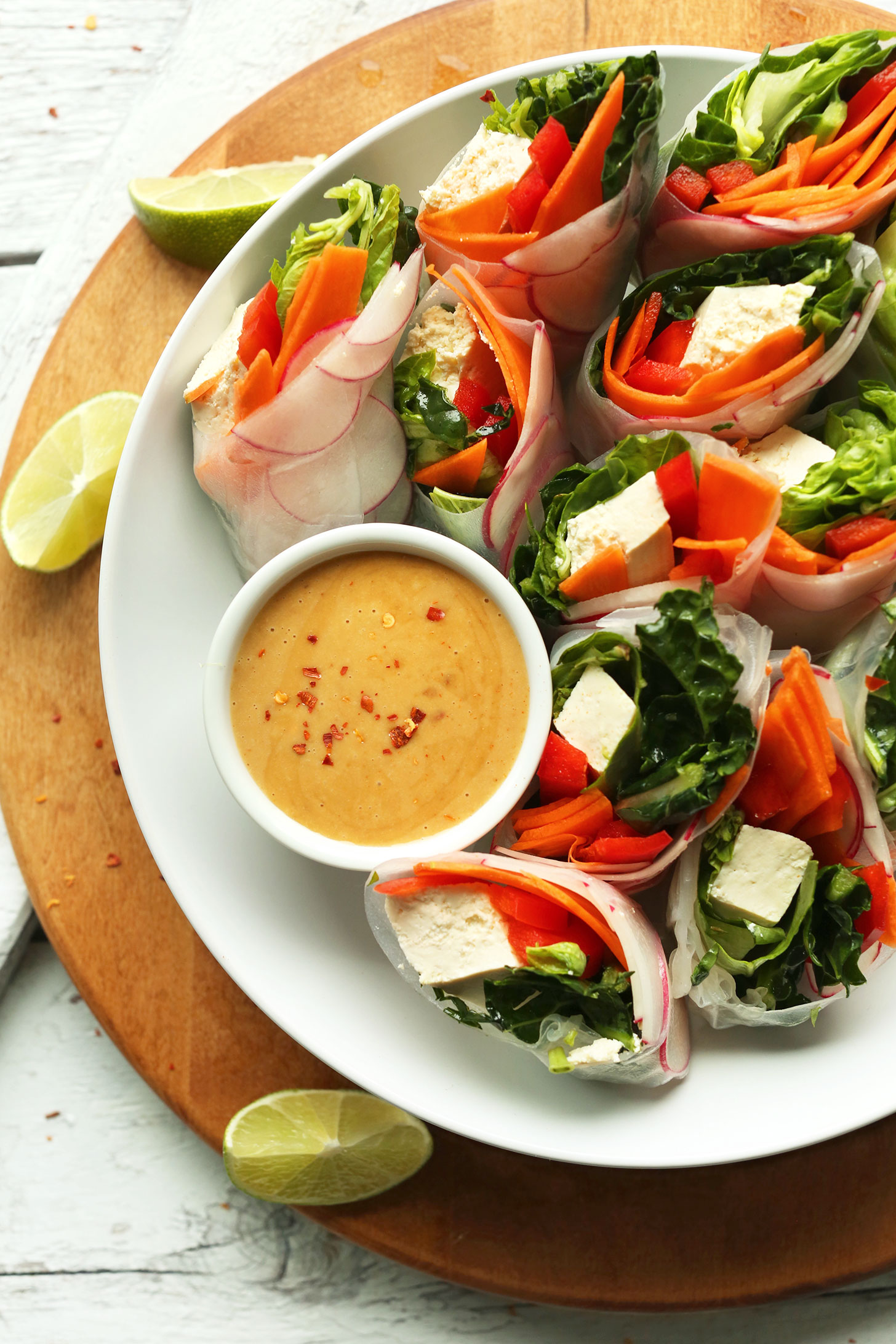 Thai Spring Rolls arranged in a bowl alongside homemade Cashew Dipping Sauce