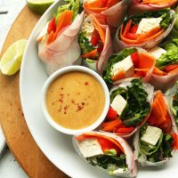 Tray of halved Thai Spring Rolls with Cashew Dipping Sauce