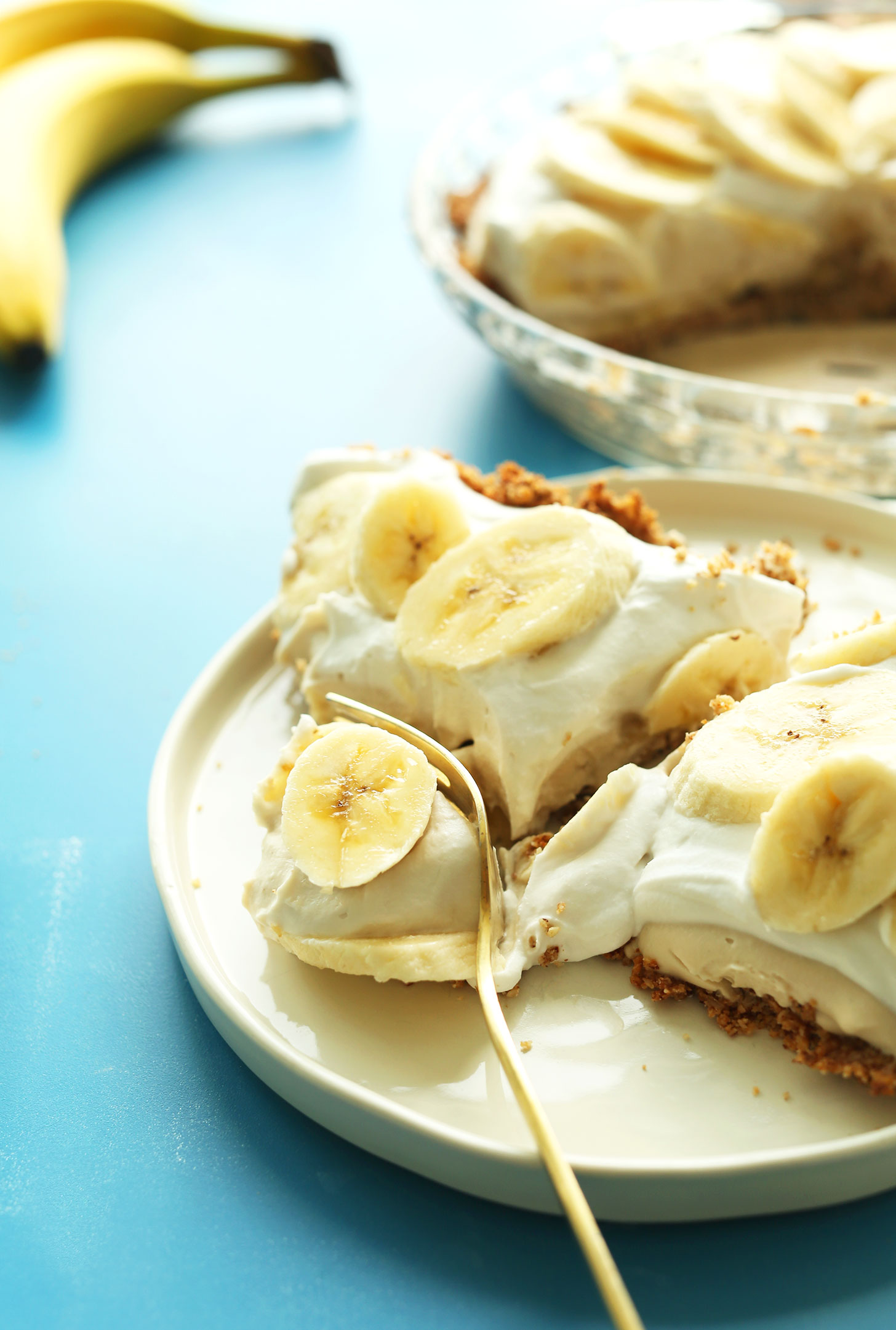 Using a fork to cut into a slice of our delicious Banana Cream PIe
