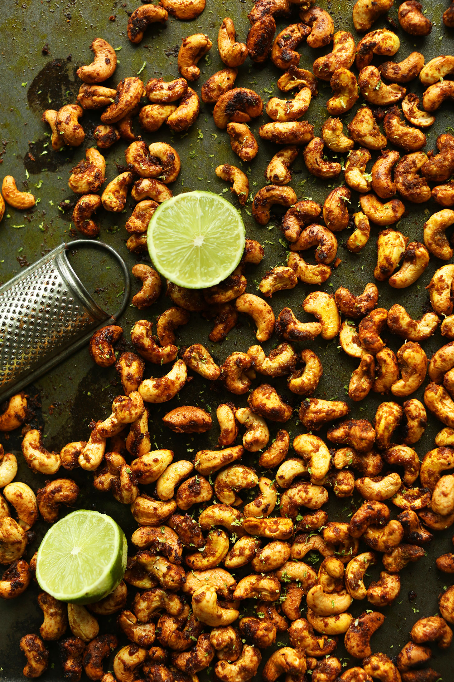 Baking sheet filled with our Green Curry-Spiced Cashews recipe