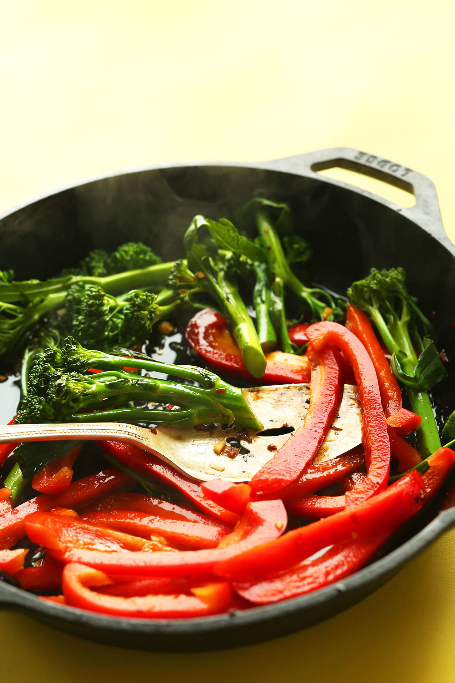 Cooking bell peppers and broccolini for a healthy vegan stir fry