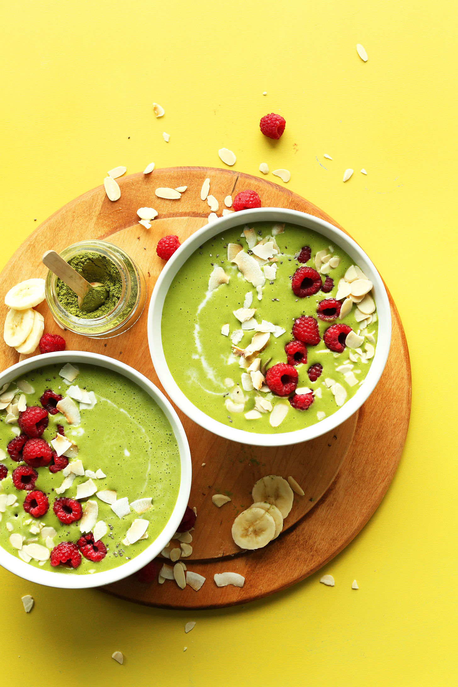 Two bowls filled with our gluten-free vegan Matcha Green Smoothie Bowl recipe