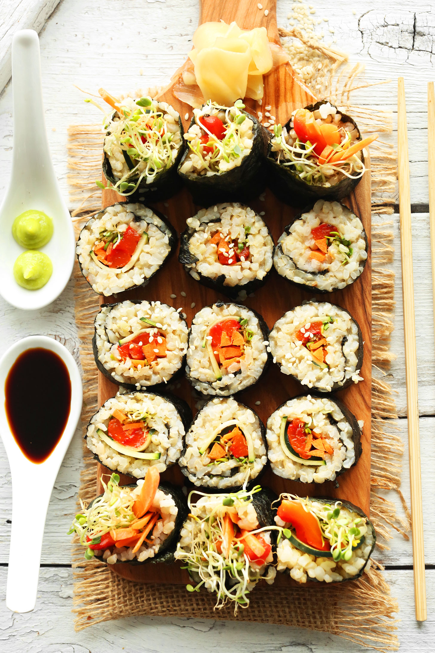 Brown rice sushi minimalist baker recipes cutting board filled with rolls of our vegan brown rice sushi recipe forumfinder Gallery