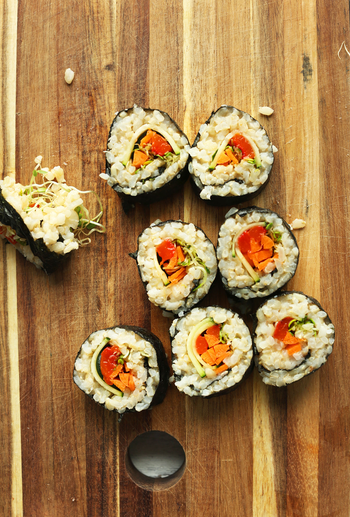 Rolls of homemade plant-based sushi on a cutting board