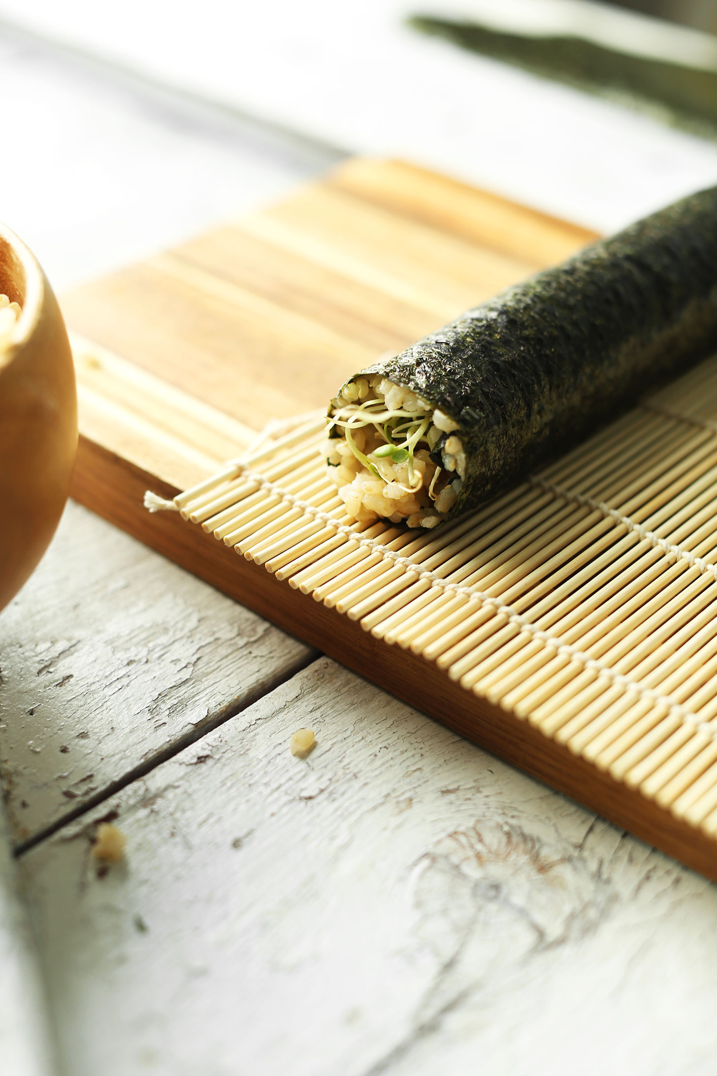 Perfectly rolled plant-based sushi on a bamboo mat
