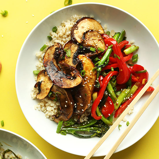 Chopsticks resting on a bowl of our flavorful Portobello Mushroom Stir Fry