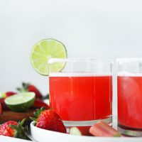 Two glasses of our Strawberry Rhubarb Margarita recipe