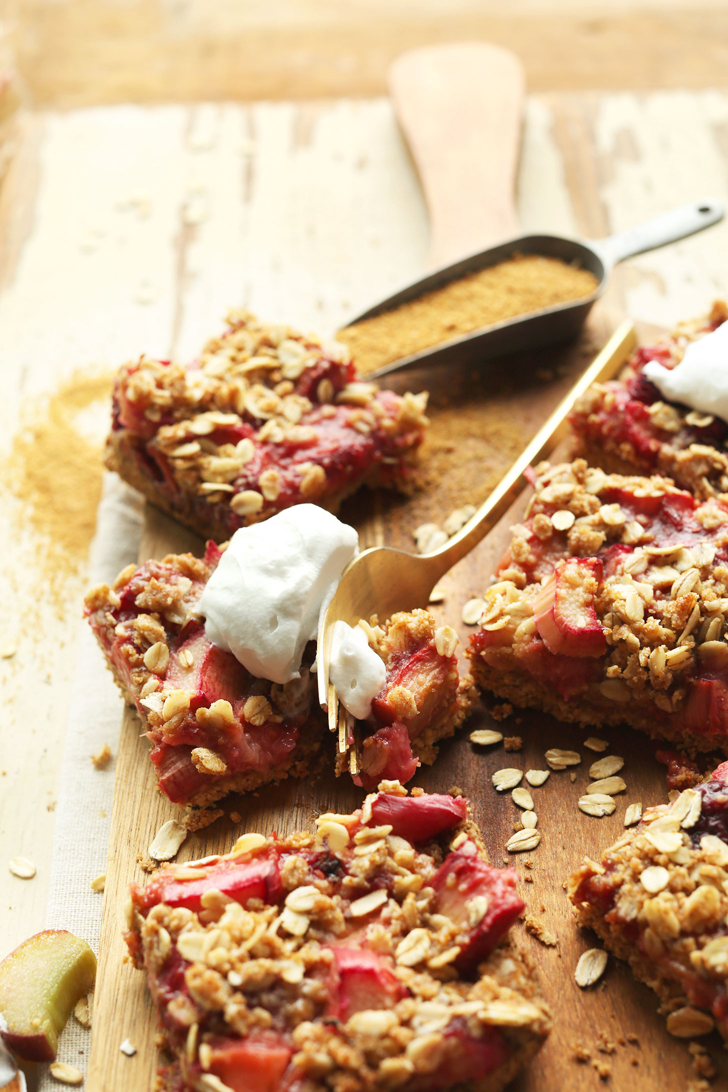 Slicing into a Strawberry Crumble Rhubarb Bar for a delicious gluten-free vegan dessert