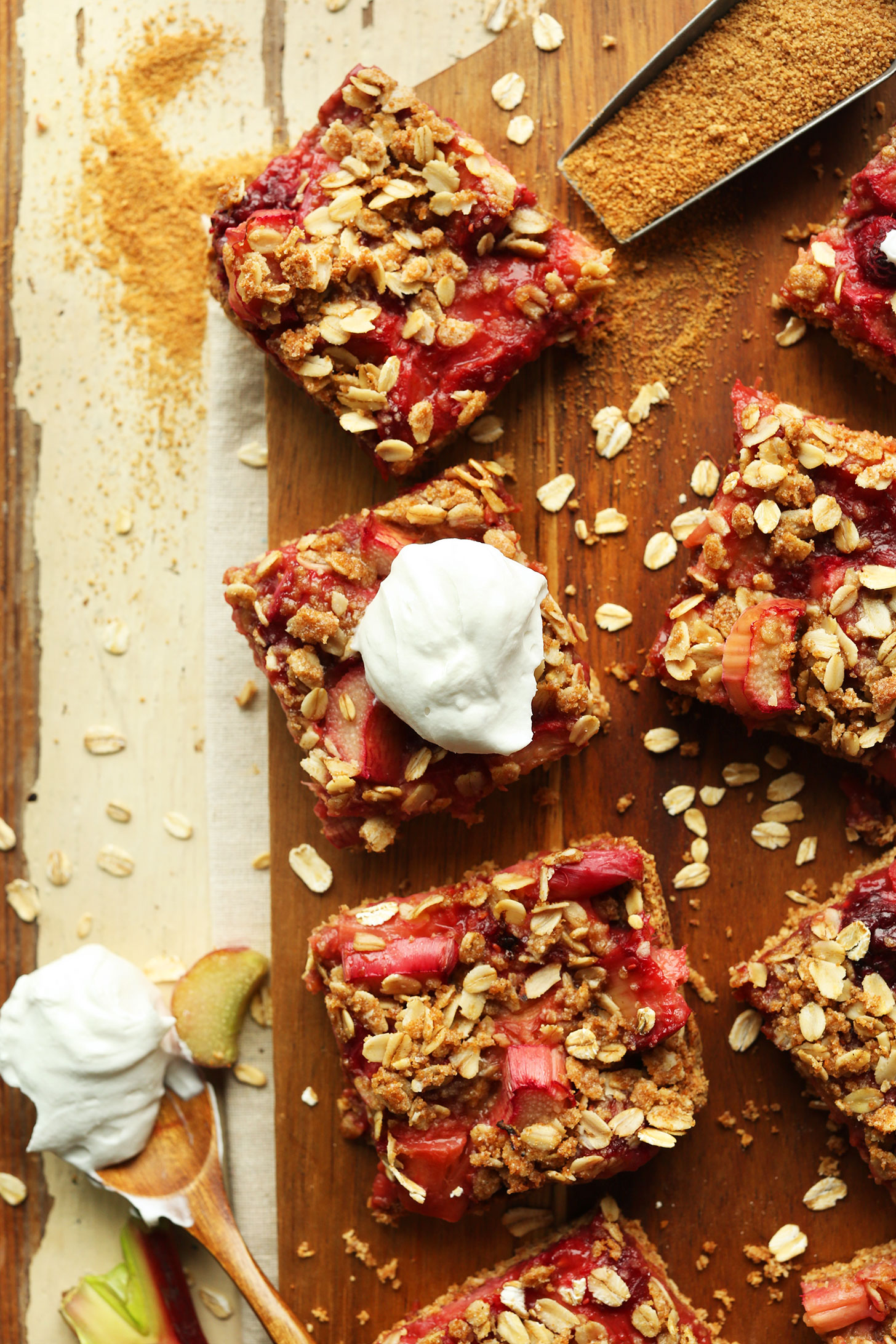 Squares of our delicious gluten-free vegan Strawberry Rhubarb Crumble Bars recipe