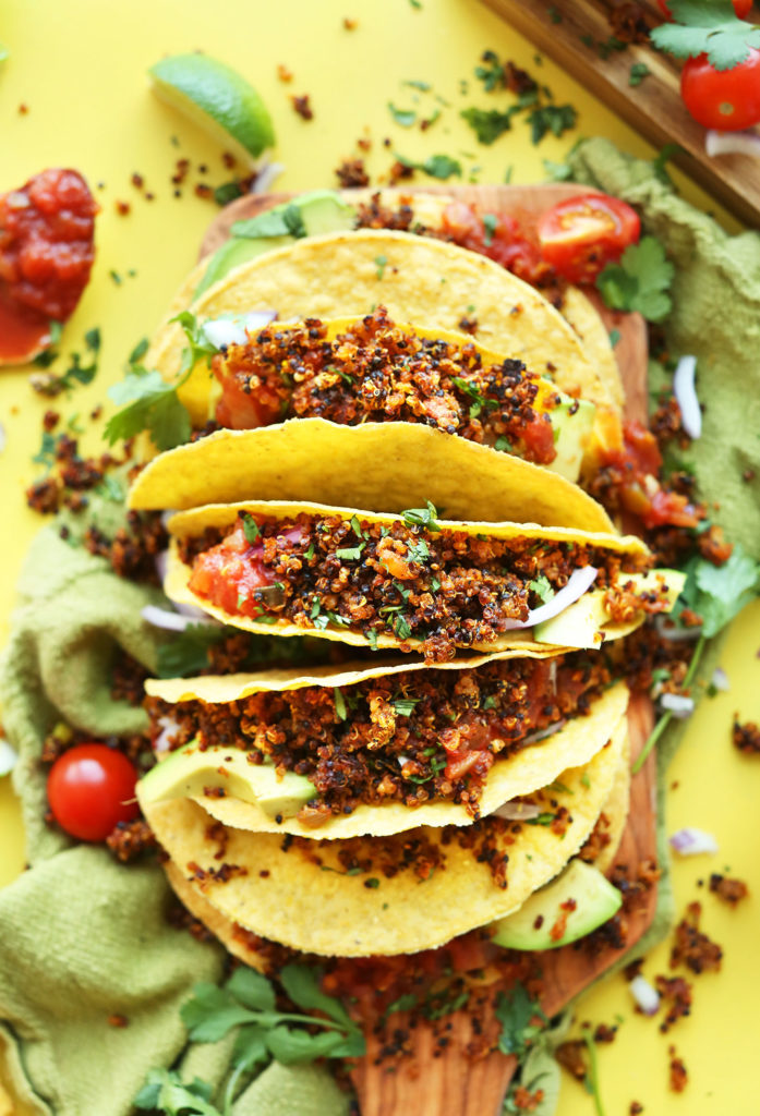 Several corn tortillas with Easy Quinoa Taco Meat for a healthy gluten-free vegan meal