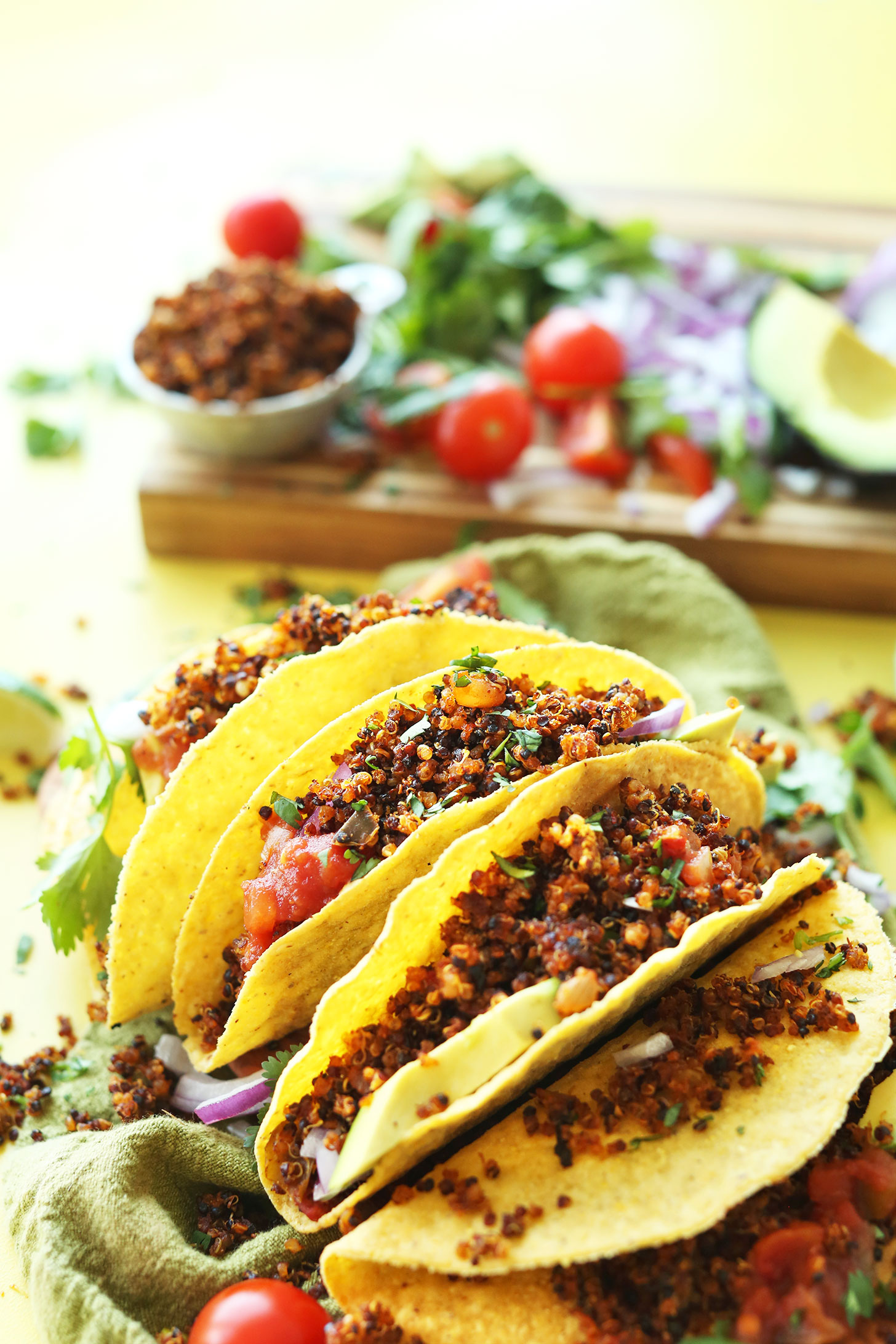 Gluten-free corn tortillas stuffed with our Vegan Quinoa Taco Meat recipe