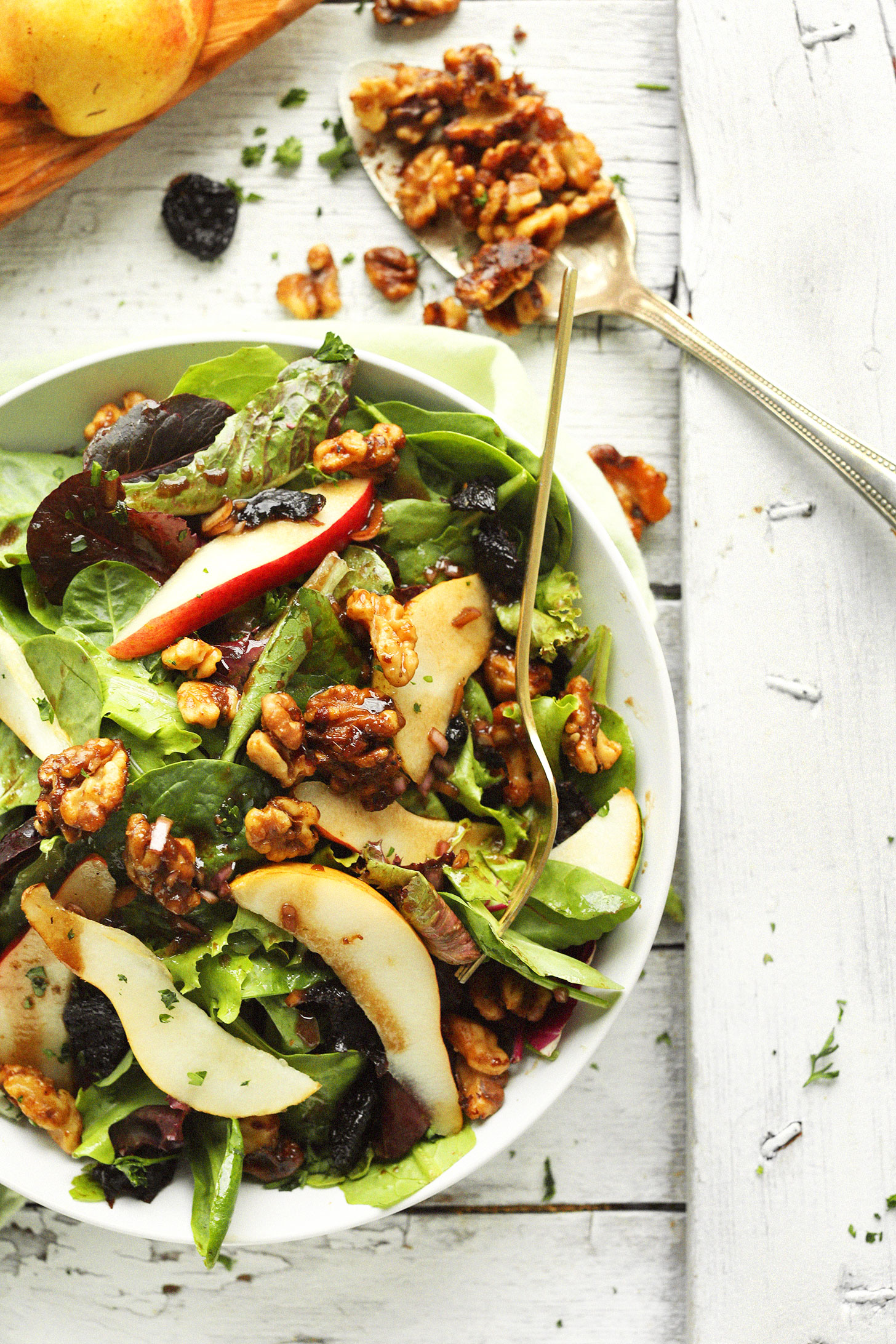 A bowl of our Easy Pear Salad with Dried Cherries and Candied Walnuts for an easy fall salad