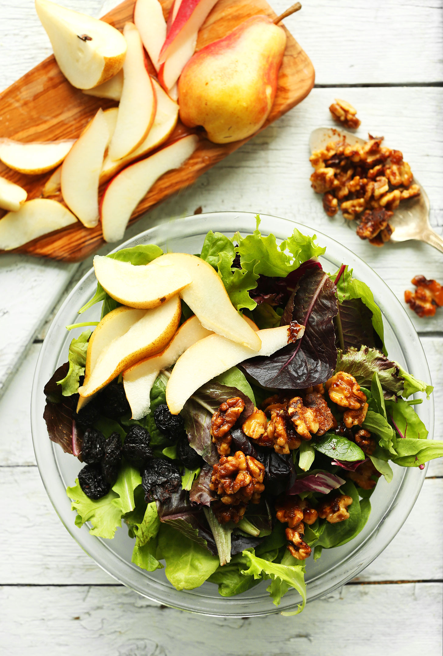 Bowl of our gluten-free vegan Pear Salad with Dried Cherries and Candied Walnuts