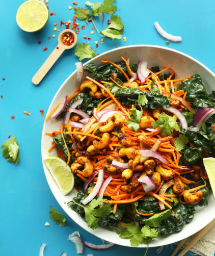 Serving bowl full of our gluten-free vegan Thai Carrot Kale Salad with Curried Cashews