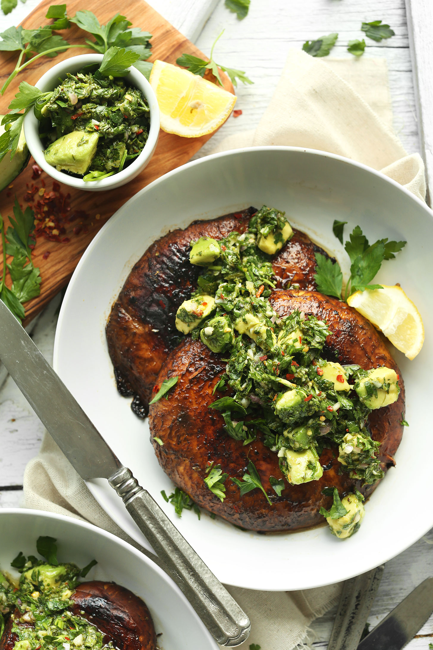 Bowl with Grilled Portobello Steaks topped with Avocado Chimichurri for a vegan grill recipe
