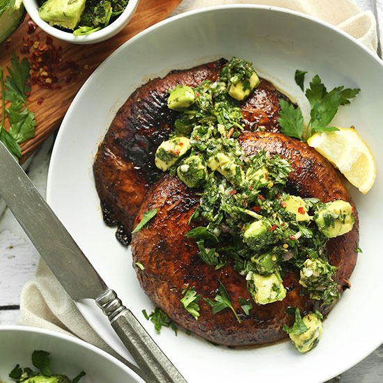 Plate with two Portobello Steaks topped with Avocado Chimichurri