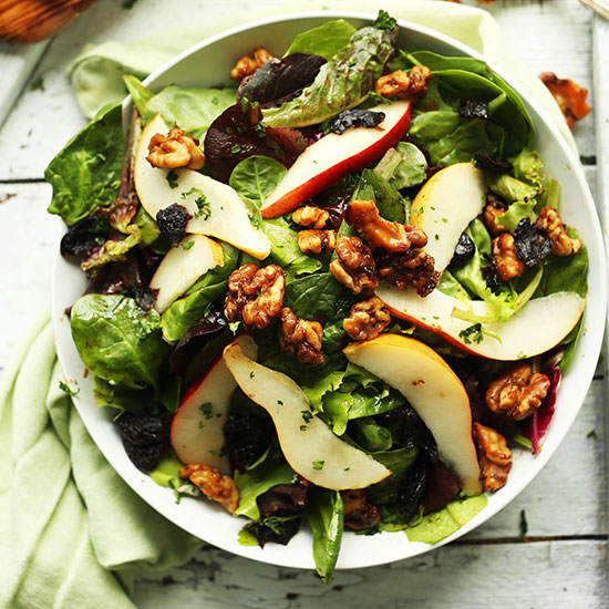 Bowl of Pear and Candied Walnut Salad for a healthy fall salad