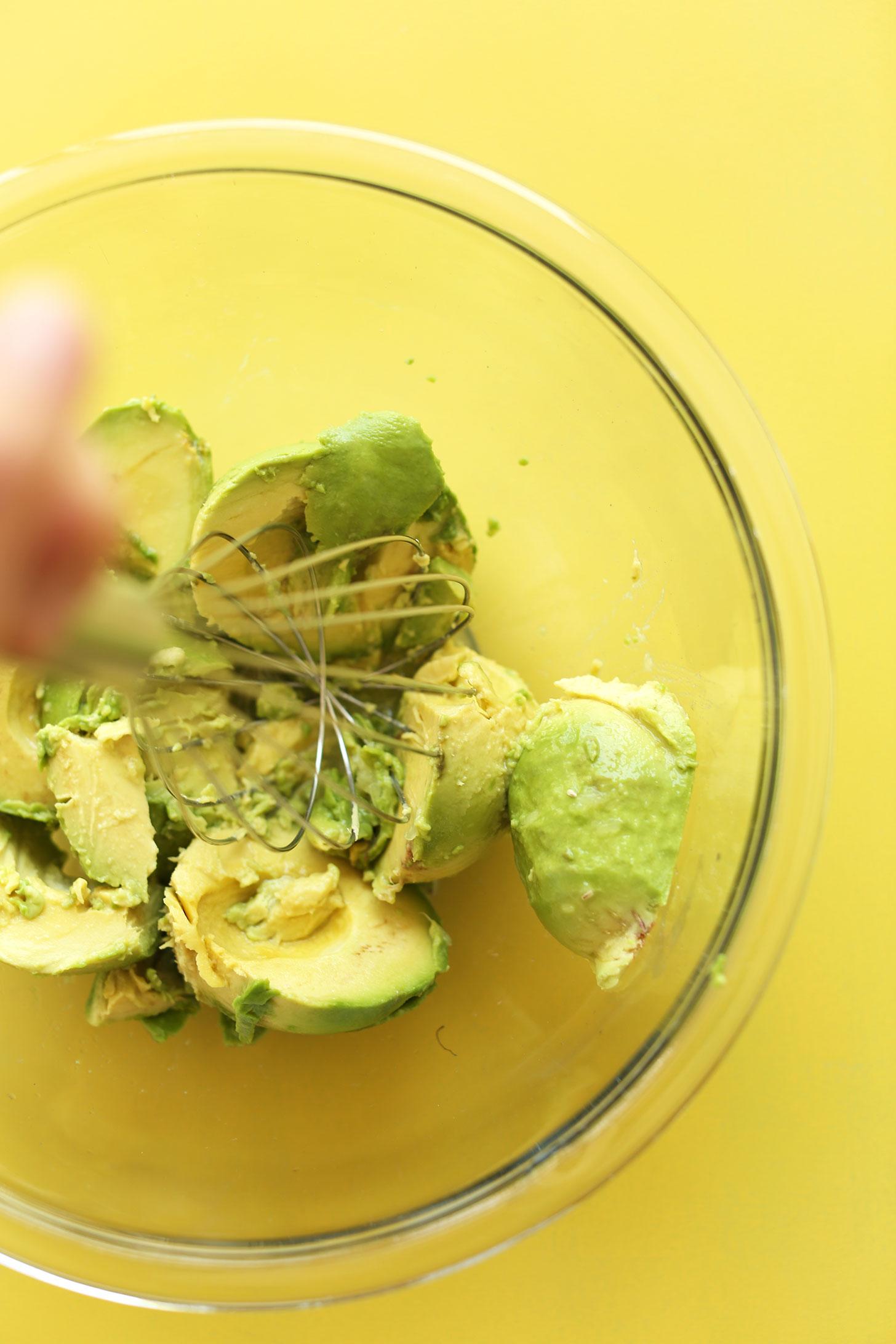 Smashing avocados for our Cauliflower Rice Burrito Bowl recipe