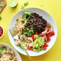 Cauliflower Rice Burrito Bowls made with guacamole, cilantro, and black beans