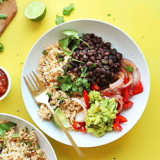 Cauliflower Rice Burrito Bowls made with guacamole, cilantro, and black beans