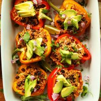 Baking pan filled with Cauliflower Rice Stuffed Peppers