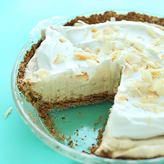 GF Vegan Coconut Cream Pie with a slice removed