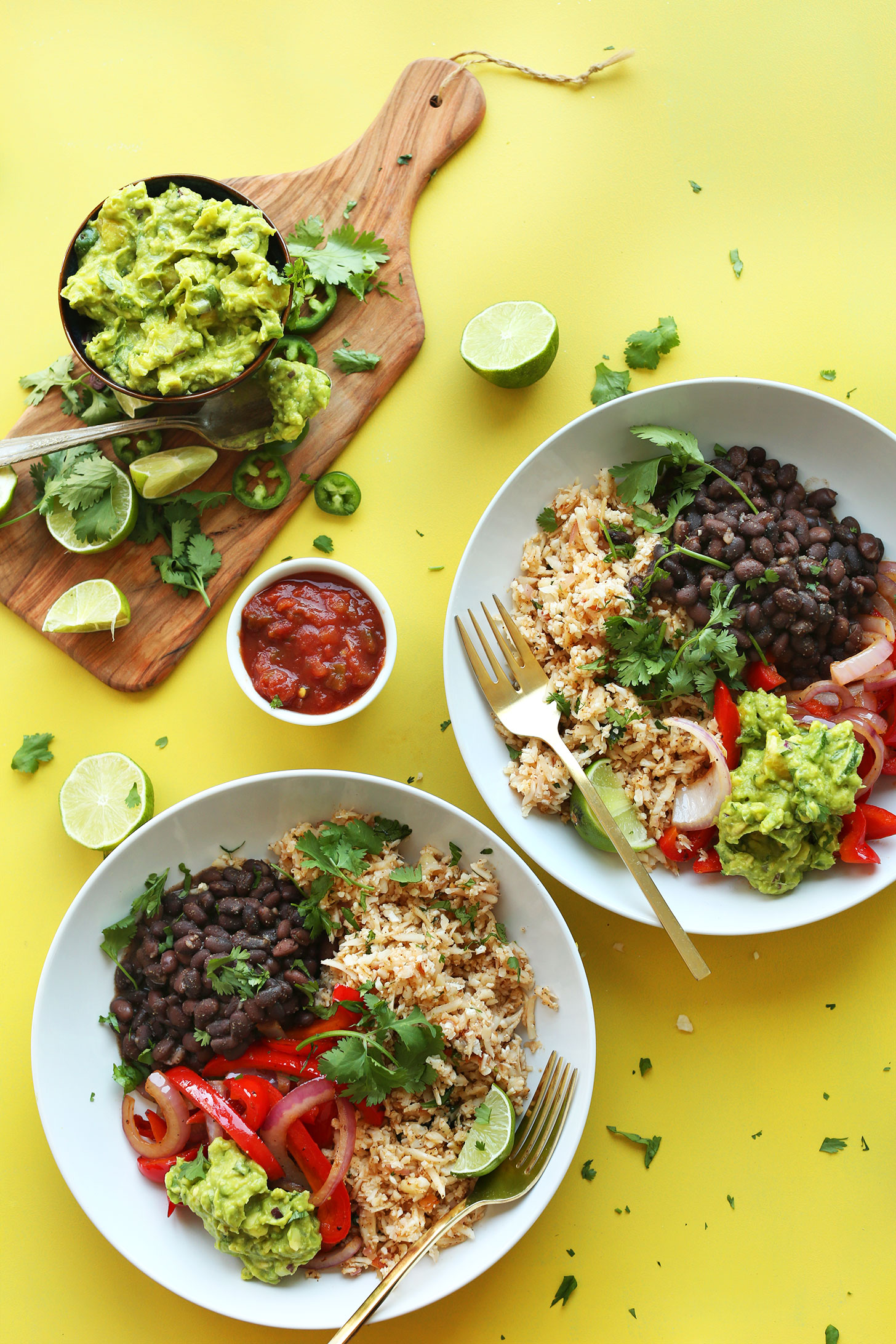 Cauliflower Rice Burrito Bowls with guacamole for a gluten-free vegan mexican meal