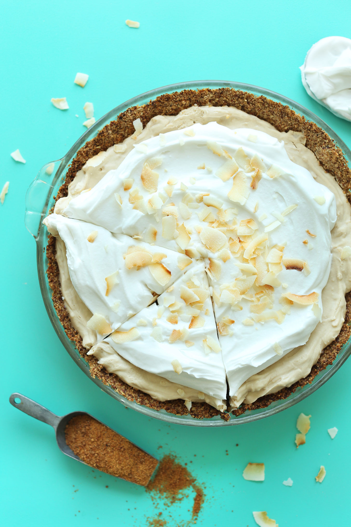 Partially sliced gluten-free vegan Coconut Cream PIe