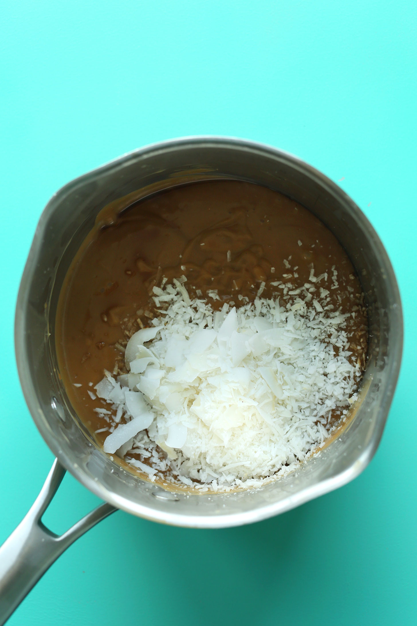 Toasting coconut in a pan for our Coconut Cream Pie recipe