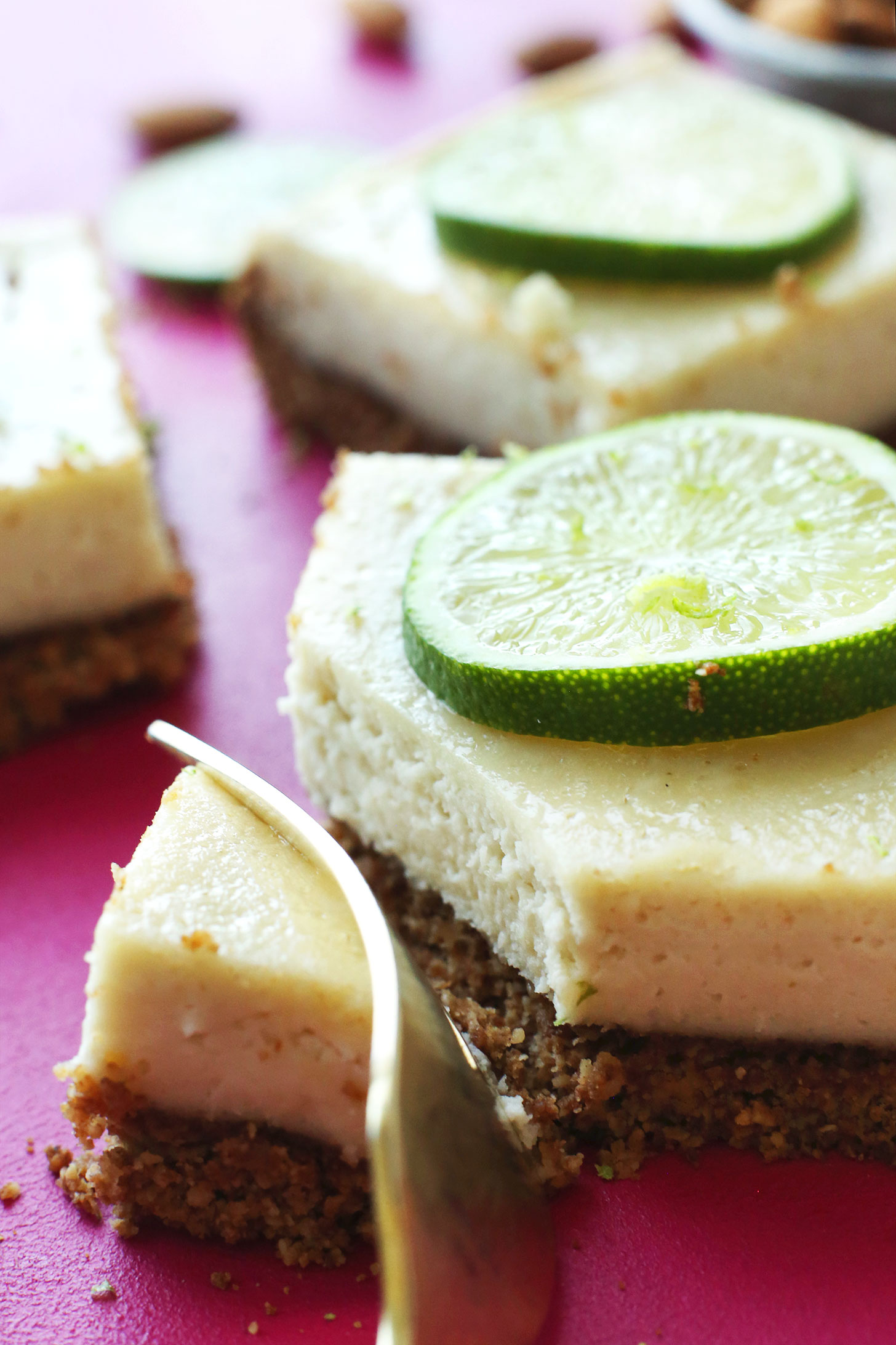 Slicing into a gluten-free vegan Key Lime Pie Bar for dessert