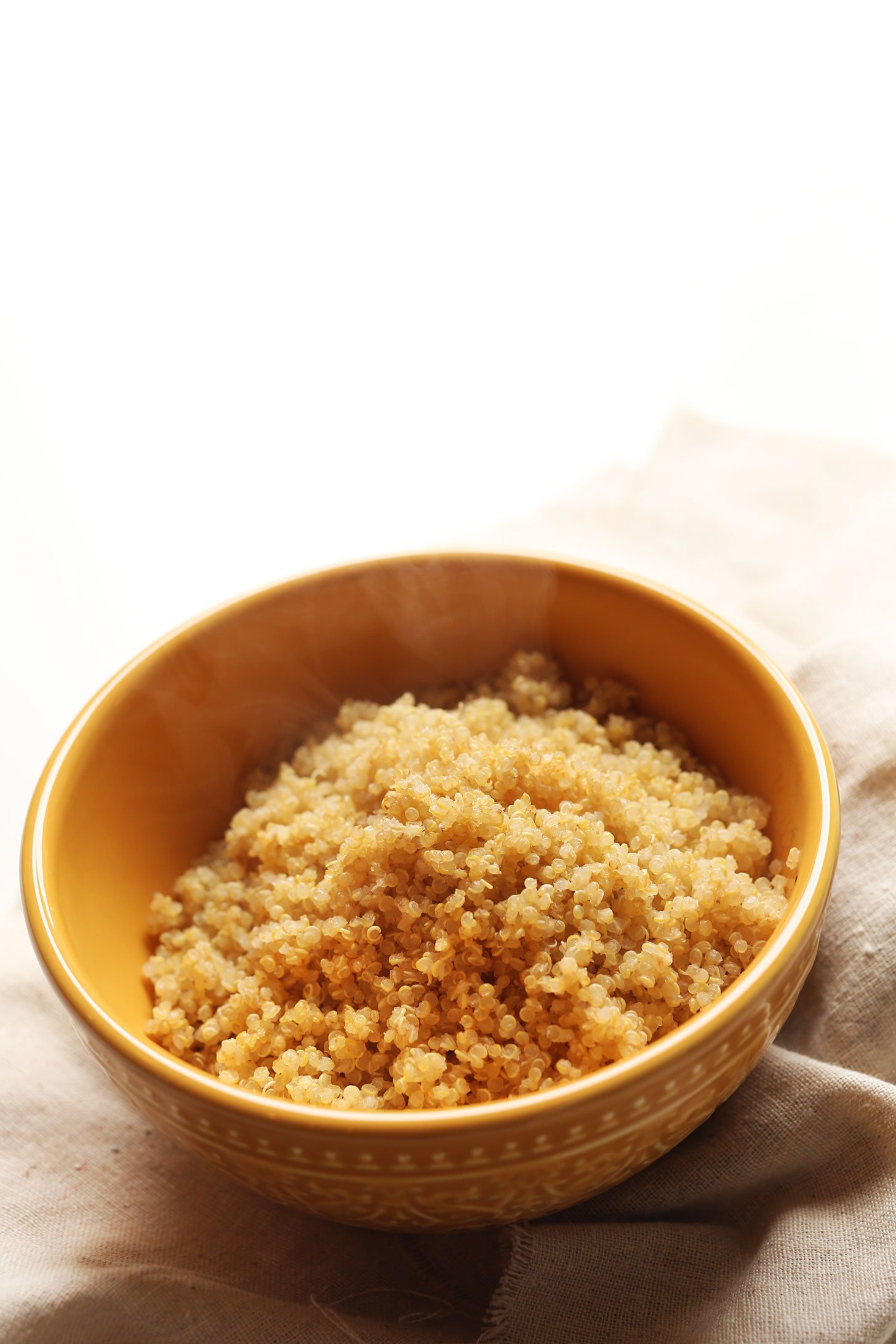 Bowl of freshly cooked quinoa prepared using our favorite method for fluffy quinoa
