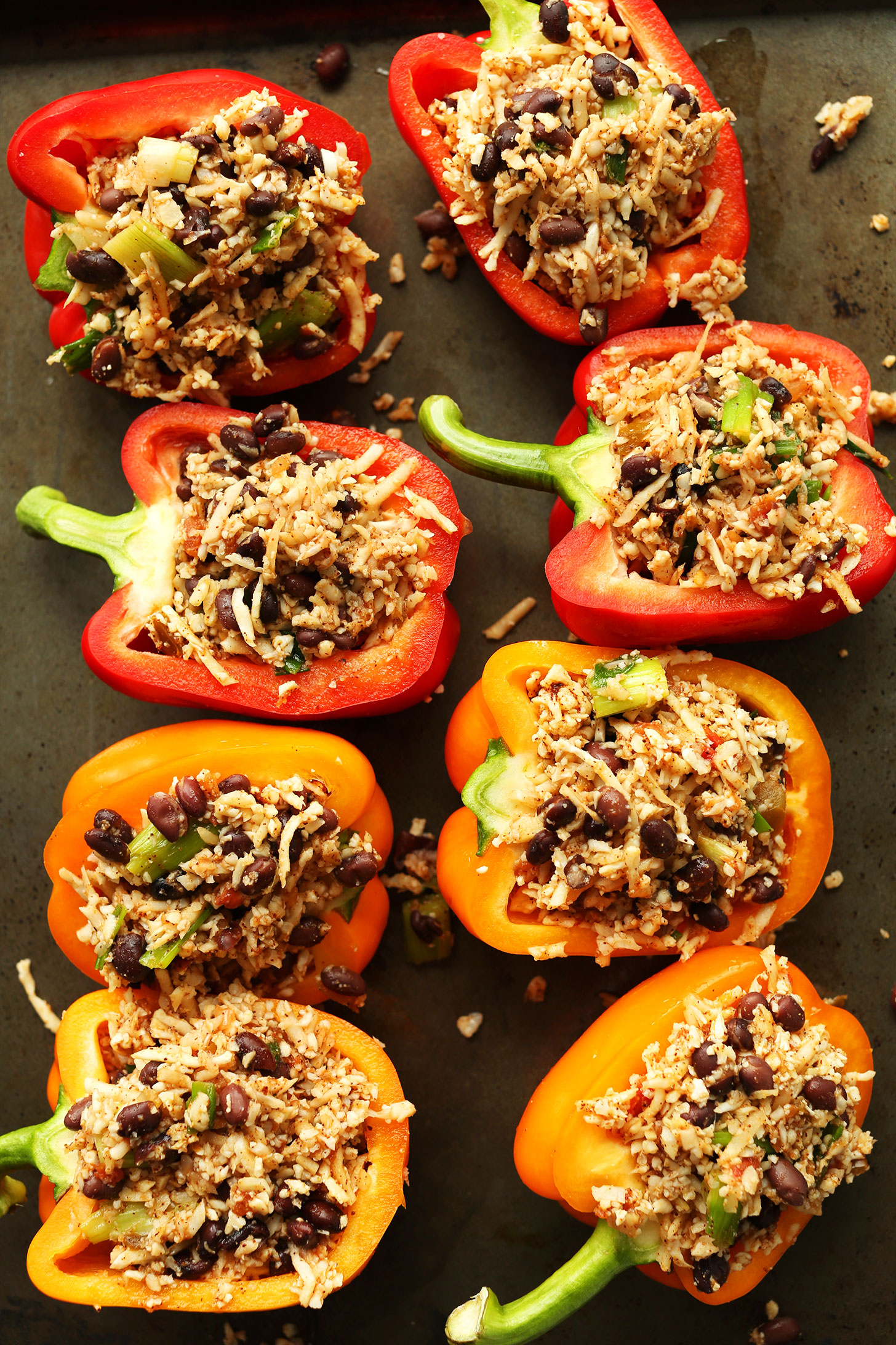 Baking sheet filled with gluten-free vegan Cauliflower Rice Stuffed Peppers