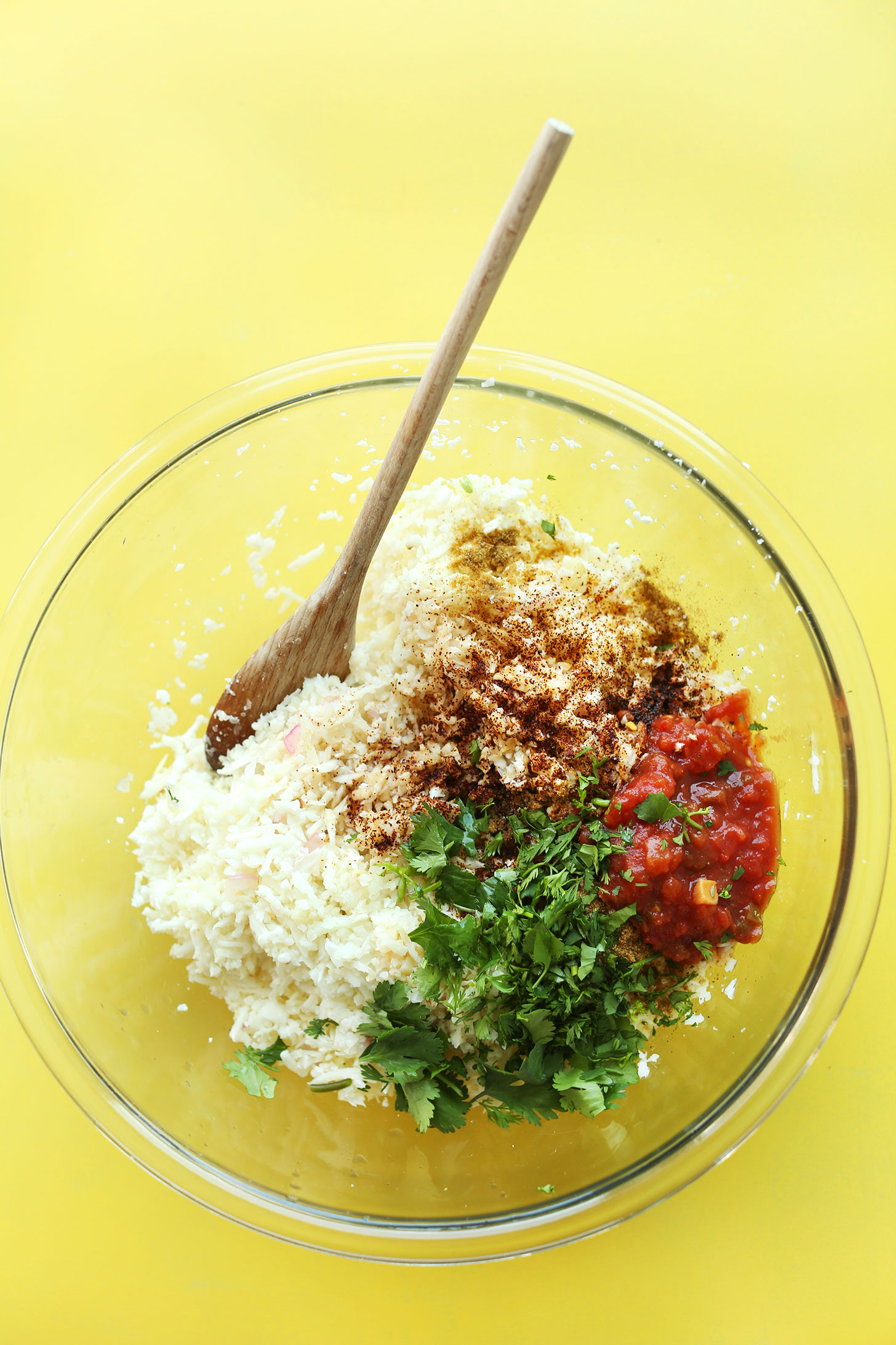 Stirring together cauliflower rice and seasonings for healthy Cauliflower Rice Burrito Bowls