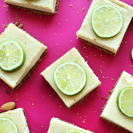 Creamy Vegan Lime Pie Bars on a hot pink background