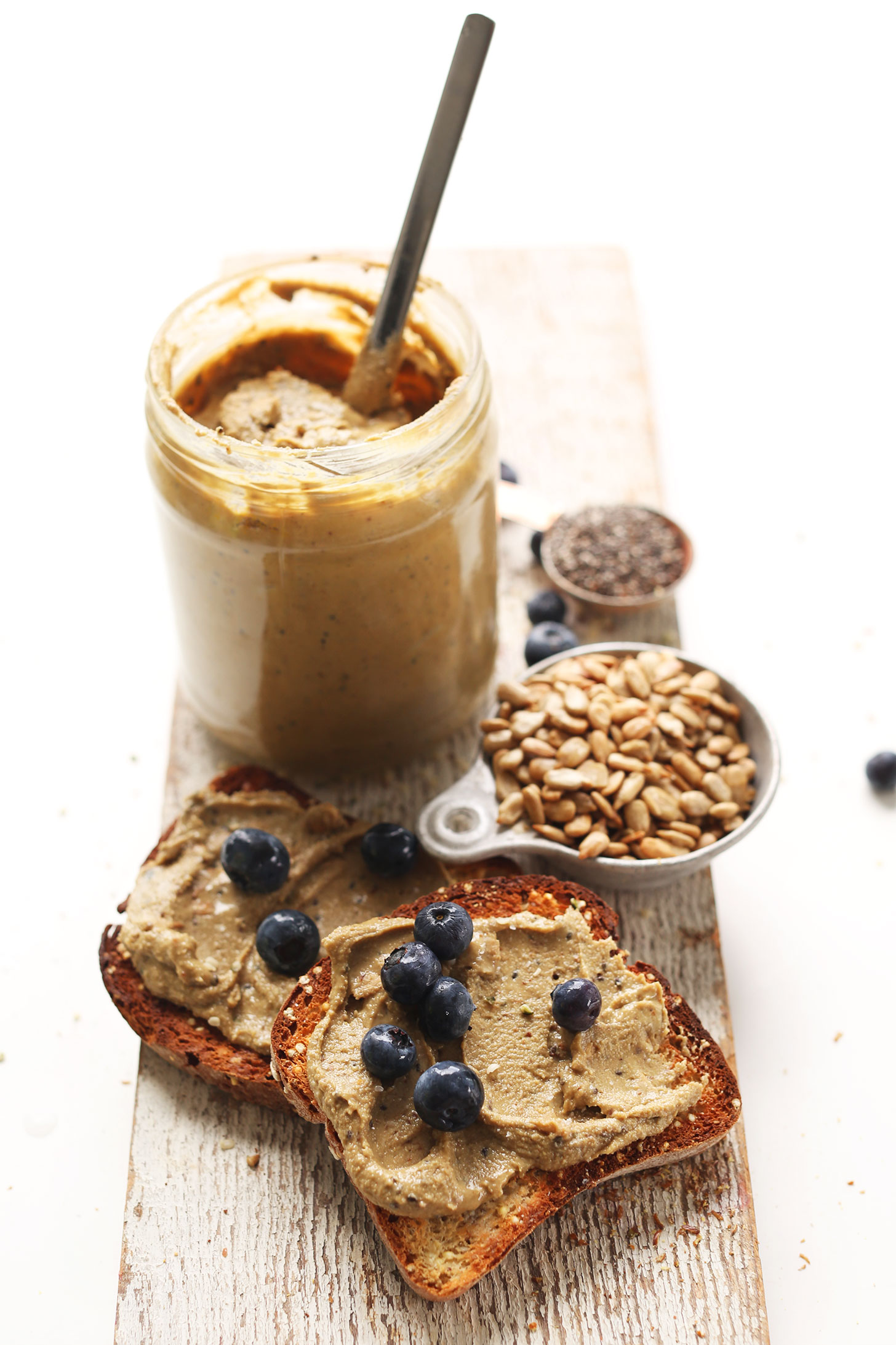 Slices of gluten-free toast topped with homemade Sunflower Seed Butter and blueberries