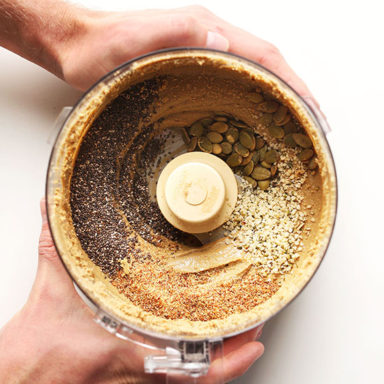 Food processor filled with a batch of our homemade Seedy Sunflower Butter recipe