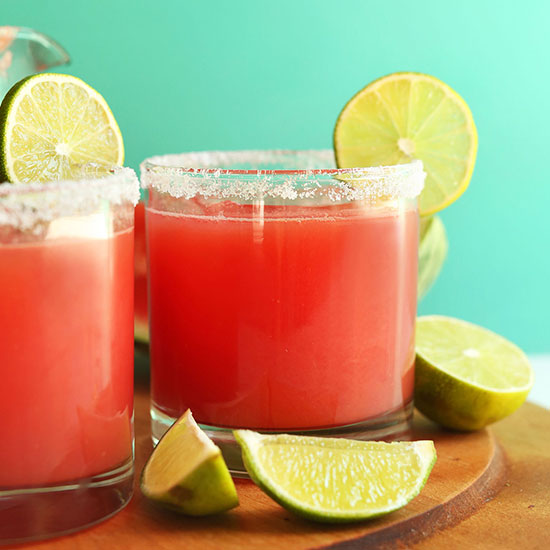Lime wedges around glasses of Watermelon Margaritas
