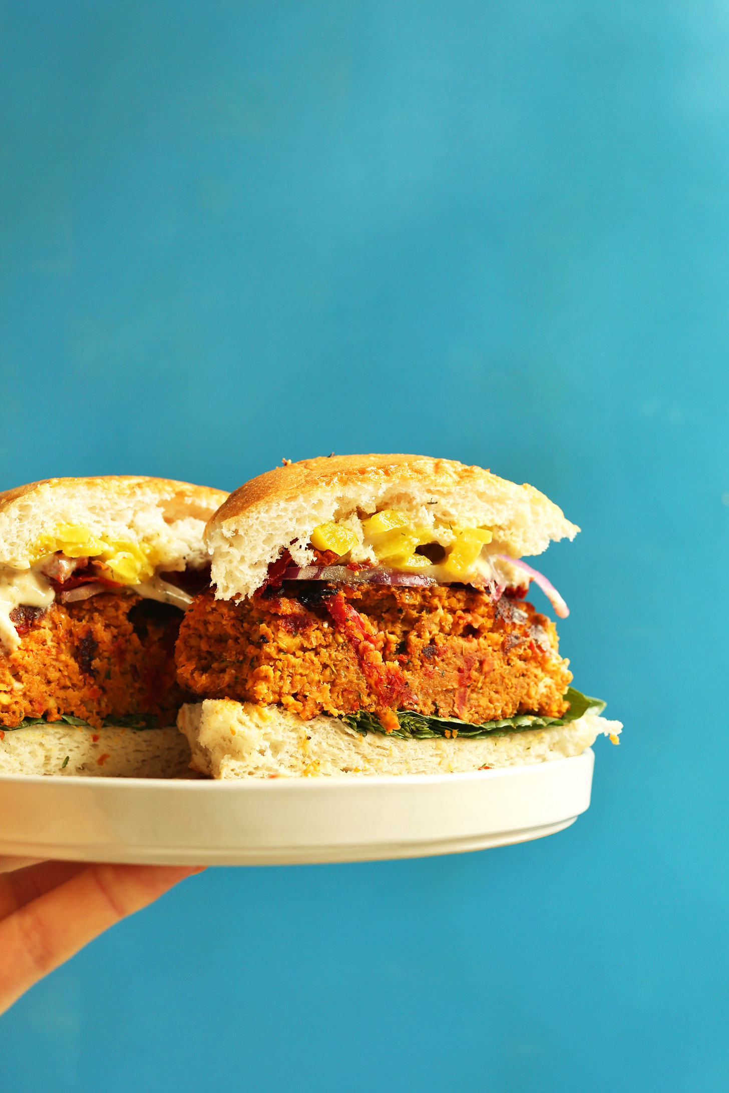 Halved Sun-dried Tomato Herbed Chickpea Burger for a delicious plant-based dinner