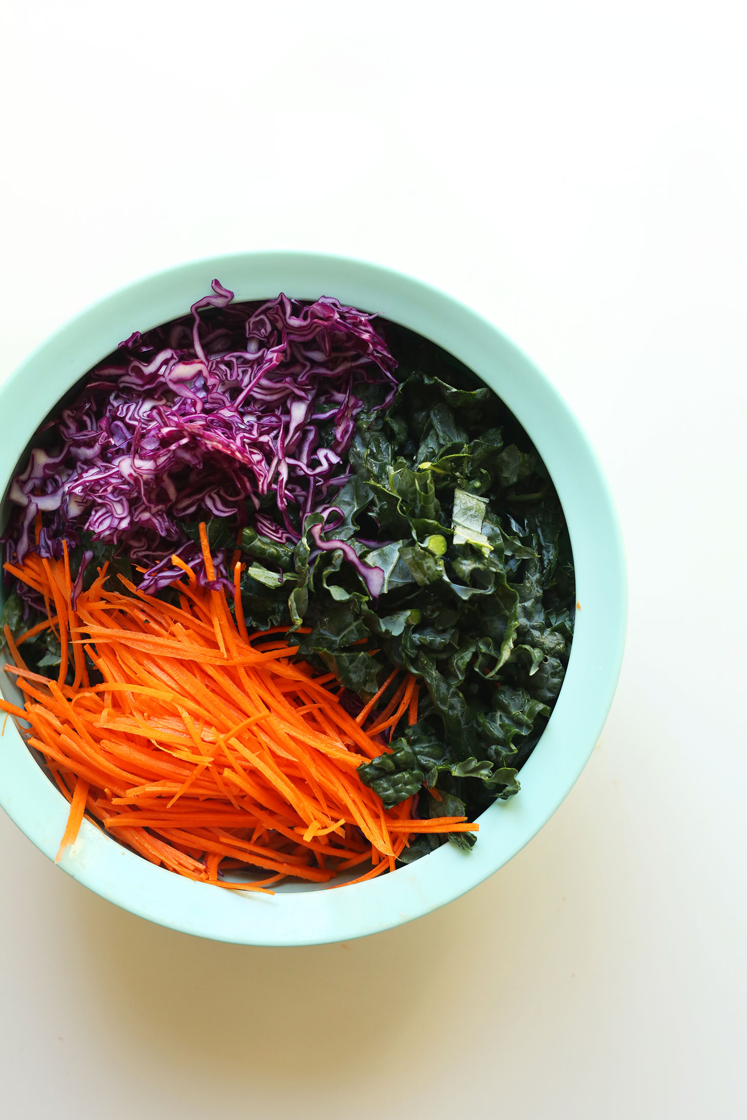 Big salad bowl with kale, red cabbage, and carrots