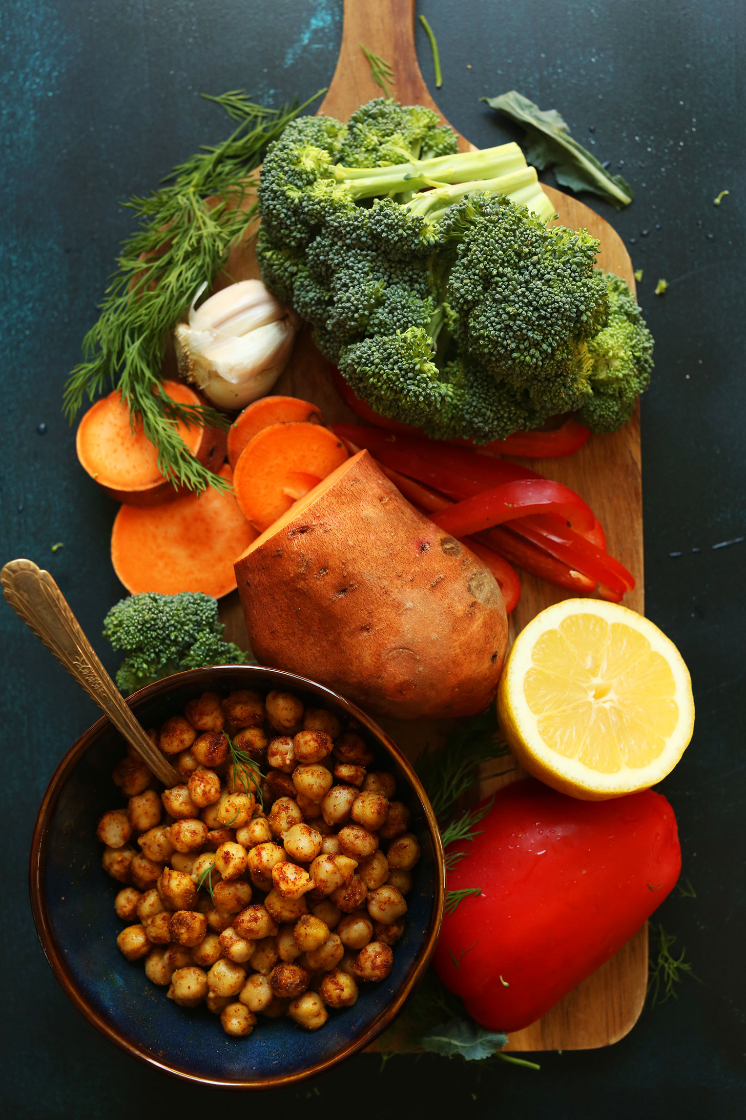 Chickpeas, lemon, sweet potato, bell pepper, broccoli, and garlic for making a healthy vegan meal
