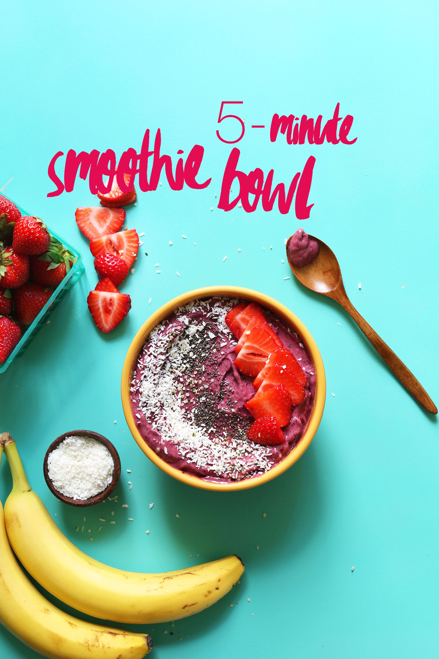 Naturally-sweetened vegan Smoothie Bowl topped with coconut, chia seeds, and strawberries