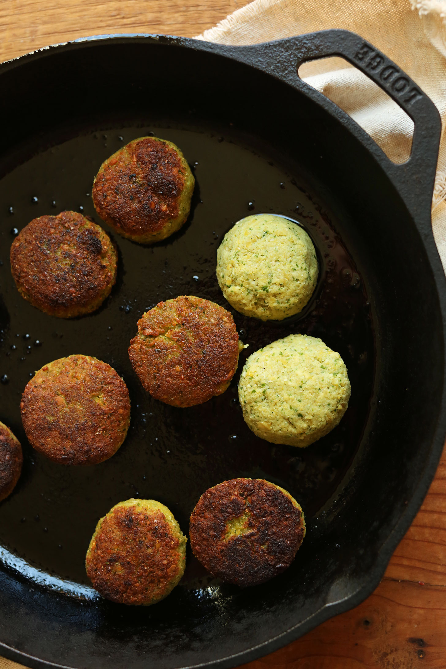 Browning gluten-free vegan falafel in a cast-iron skillet for a plant-based meal