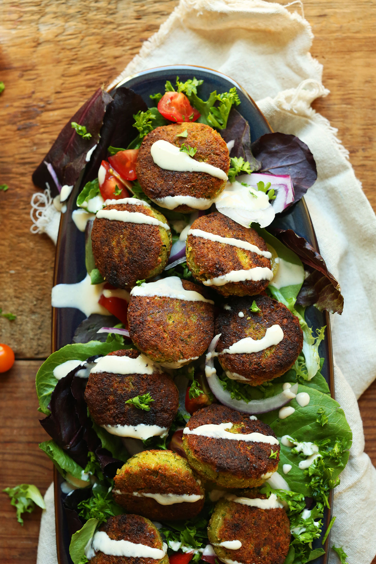 Platter with mixed greens topped with our 10-ingredient Classic Vegan Falafel recipe