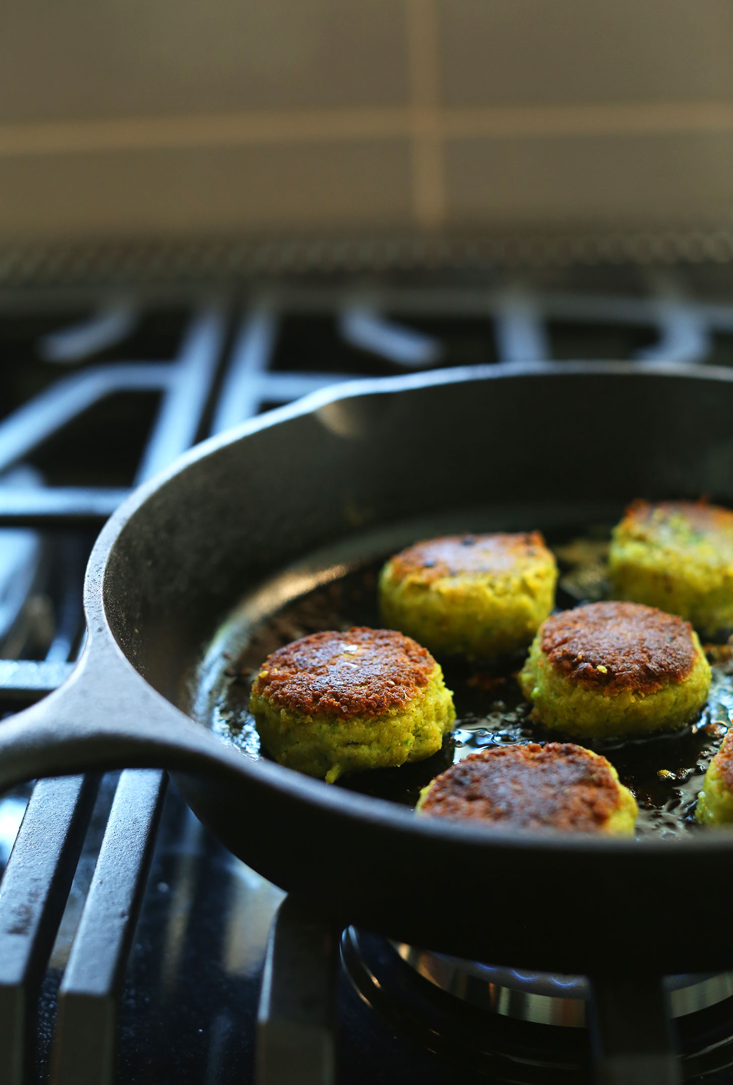 Cooking vegan falafel in a cast-iron skillet for Mediterranean Bowls