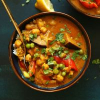Bowl of our delicious veggie-packed Red Coconut Curry with Chickpeas