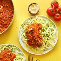 Plates of zucchini pasta with lentil pasta sauce